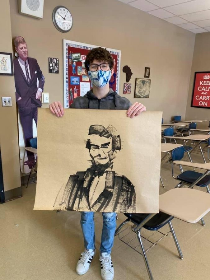 """The next Pablo Picasso. Hood used cardboard and ink to create a portrait of Abraham Lincoln in AP Art. I was experimenting with what I could do on a piece of cardboard. I used the ink as paint. It was fun and easy to make,"""" senior Drew Hood said."""